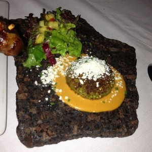 Diamond black rattlesnake cake in a pistacio nut crust coiled atop a spicy chipotle cream. Photo Credit JKI @foodspotting