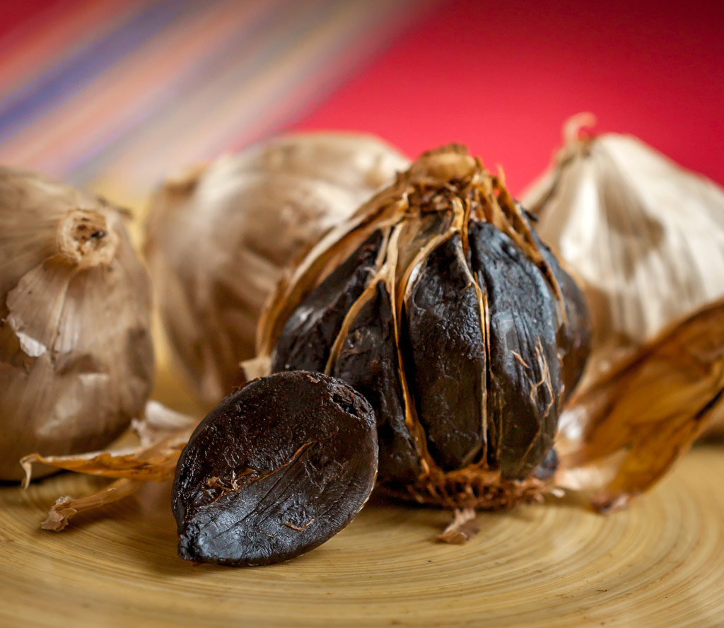 Black Garlic Cloves and Whole Heads